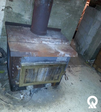 The sole-source conversion program helped owners replace old coal stoves like the one pictured with new natural-gas furnaces.