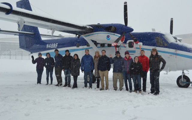 Researchers for the Winter PM2.5 study stand in front of the Twin Otter plane