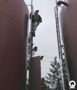 Scott Hacking, DEQ District Engineer, inspecting water storage tanks in Camp Timberlane