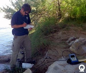 DWQ's Ben Brown sampling the San Juan River.