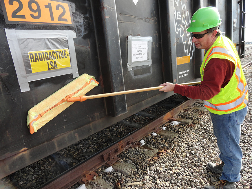 Environmental scientists from DWMRC conduct almost-daily inspections on rail cars and containers arriving at EnergySolutions to test their radiation levels.