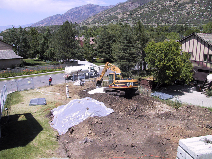 The long-term remedy for soil contamination in residential and commercial areas from historic ore-processing at the Davenport and Flagstaff smelters included excavation, onsite treatment of waste, offsite disposal of material, site restoration, and institutional controls.