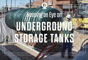 Image of men installing an underground storage tank