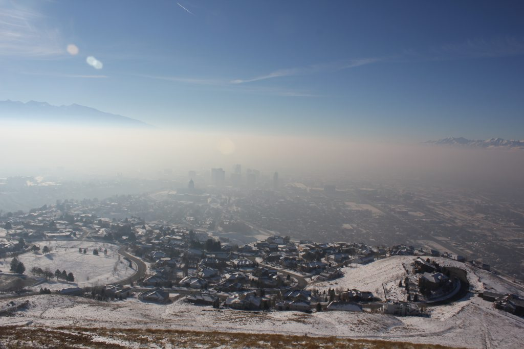 Employer-based trip reduction programs can reduce the pollution trapped near the ground during inversions. Photo shows polluted air over Salt Lake City.