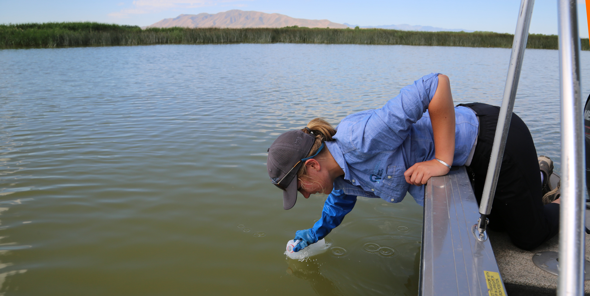 Utah Division of Water Quality employee Kelsee York samples Utah Lake