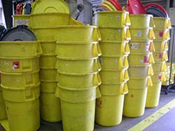 Empty yellow waste cans.