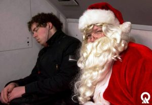 Author Jared Fry sometimes sleeps on public transit. In this photo, Santa took a selfie with a sleeping Jared.