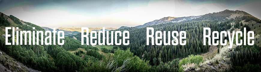 wide landscape shot of forest with words Eliminate, Reduce, Reuse, Recyle