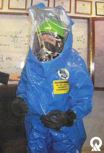 Marie Owens in protective gear to check out a drinking water system.